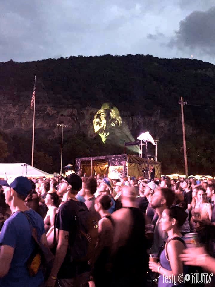 Del McCoury projection on the mountain at DelFest 2019