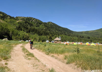 Outbound-Pursuit-2019-biking-through-camp